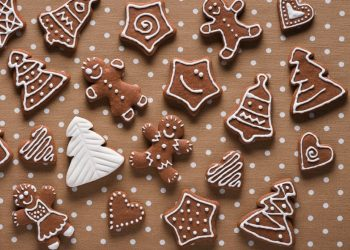 Homemade gingerbread on beige dots background top view by Kamil Zabłocki