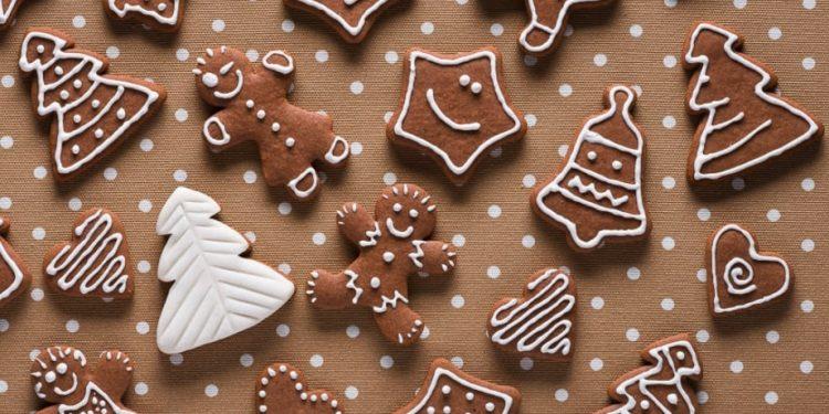 Homemade gingerbread on beige dots background top view by Kamil Zabłocki